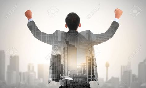 37804164-success-business-man-raise-his-hand-double-exposure-concept-of-businessman-and-city-stock-photo
